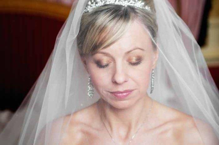 Bride through the veil.